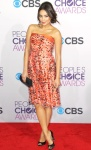 Shay Mitchell in a strapless coral Giorgio Armani dress with a black Chanel clutch & Jimmy Choo peep toe pumps