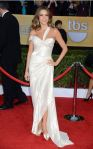 Sofia Vergara in a white Donna Karan gown with white peep toe shoes