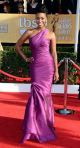 Teyonah Parris in a violet one-shoulder gown