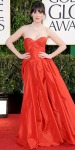 Zooey Dechanel in a red sweetheart Oscar de la Renta gown with a vintage-inspired ponytail