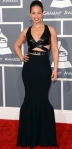 Alicia Keys in a black banded leather accented gown by Azzedine Alaia