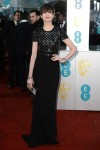 Anne Hathaway in a black short-sleeved Burberry gown