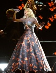 Carrie Underwood in a silver custom-designed Theia dress with projected illustrations