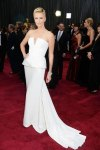 Charlize Theron in a white strapless peplum Dior Haute Couture gown with Harry Winston jewels