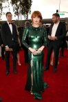 Florence Welch in an emerald liquid metal gown by Givenchy