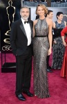 George Clooney & Stacy Keibler in a silver metallic sequined Naeem Khan gown