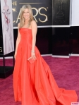 Jennifer Aniston in a strapless red ballgown by Valentino