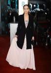 Jennifer Lawrence in a blush embellished gown with a Christian Dior coat