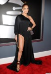 Jennifer Lopez in a black high slit one-shoulder Anthony Vaccarello gown