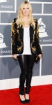 Kaley Cuoco in an embellished Amen jacket with black leather pants & suede pumps