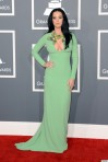 Katy Perry in a mint green long-sleeved open front embellished gown by Gucci