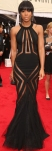 Kelly Rowland in a black sheer cut-out gown by Georges Chakra
