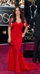 Marcia Gay Harden in a red David Meister gown