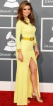 Maria Menounos in a belted canary yellow dress by Gomez-Garcia with strappy gold sandals.