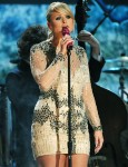 Miranda Lambert in a neutral & silver beaded long-sleeve mini dress by Jovani Couture