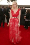 Natasha Bedingfield in a red lace overlay gown by Emerson