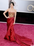 Olivia Munn in a red & gold bodiced gown by Marchesa