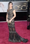 Sandra Bullock in a black embellished lace overlay cap sleeve gown by Elie Saab