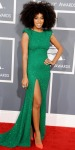 Solange Knowles in a sparkling green high slit gown with studded neon orange pointy toe high heels