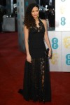 Thandie Newton in a black lace Louis Vuitton halter gown
