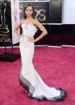 Zoe Salanda in a white embellished fishtail gown by Alexis Mabille with Roger Vivier shoes