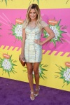 Ashley Tisdale in an embroidered Rafael Cennamo dress with silver ankle strap sandals