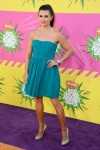 Danica Patrick in a turquoise weetheart dress with silver platforms heels