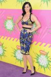 Katy Perry in a printed Herve Leger by Max Azria two-piece outfit with black pointy toe pumps