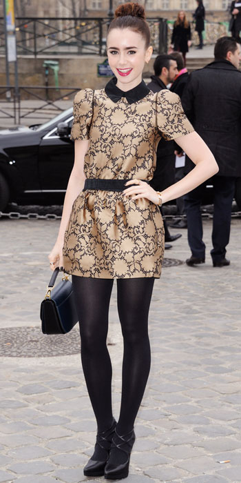 Lily Collins In A Gold Black Printed Minidress With Black Opaque
