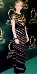 Michelle Williams in a black & gold deco column gown by Jason Wu
