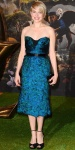 Michelle Williams in a feathered Burberry bustier dress with black ankle strap Jimmy Choo platform sandals