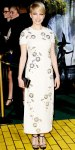 Michelle Williams in an embellished Prada column gown with jeweled ankle strap sandals & black clutch