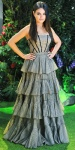 Mila Kunis in a strapless tiered Alexander McQueen ball gown