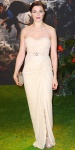 Rachel Weisz in a cream embroidered lace strapless belted column gown by Michael Kors with a sparkling minaudiere with metallic Tabitha Simmons sandals