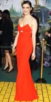 Rachel Weisz in a scarlet column gown with a gold box clutch