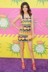 Victoria Justice in a printed Pia Pauro dress with coral ankle strap sandals by Aldo