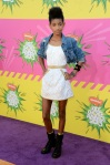 Willow Smith in a white dress with a denim jacket & black combat boots