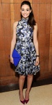 Emmy Rossum in a floral halter dress with an oversized envelope clutch & fuchsia Jimmy Choo pumps.