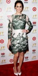 Emmy Rossum in a floral printed Topshop dress with white pumps & an Ippolita ring.