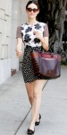 Emmy Rossum in a printed mini dress by Topshop with a colorblock Christian Louboutin tote & patent leather ballet flats.