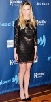Kirsten Dunst in a black lace & leather mini dress by Emilio Pucci with black pointy toe pumps.