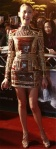 Olga Kurylenko in a bamboo-inspired Balmain mini dress with metallic Jimmy Choo sandals.