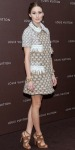 Olivia Palermo in a Louis Vuitton embellished shift dress with a woven bracelet & suede strappy sandals.