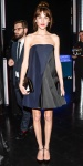 Alexa Chung in a colorblocked navy & black Dior dress with black ankle strap heels.