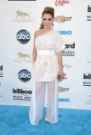 Alyssa Milano in a one-shoulder belted ensemble by Emilio Pucci.