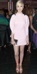 Anne Hathaway in a pink mod mini dress by Givenchy with a mirrored clutch & strappy gold sandals.