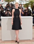 Carey Mulligan in a black belted dress by Chloe with black peep toe platforms.