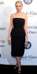 Carey Mulligan in a black peplum Calvin Klein Collection dress with ankle-strap Brian Atwood platforms.