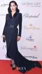 Dita von Teese in a black belted Alexis Mabille gown.