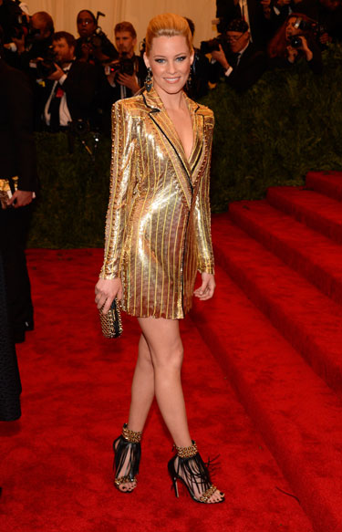 Elizabeth Banks in a gold deep-v Atelier Versace dress with black ...